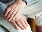 Elderly person hands crossing