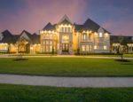 A large mansion at night.