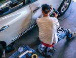 Man working on a car.