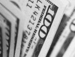 Closeup photo of $100 banknotes.