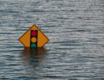 A traffic sign during a Mississippi flood.