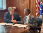 Attorney General William Barr and HUD Secretary Ben Carson sign a memorandum of understanding concerning False Claims Act violations.