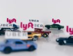 Uber and Lyft conceptual road concept using toy cars.