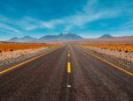 A long road heading into a horizon.