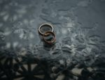 Two bronze rings together in the rain.