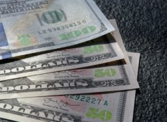 A grouping of American currency: three $50 bills and one $100 bill.