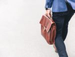 A man walking with a briefcase.