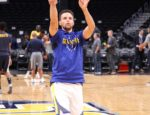NBA Point Guard Steph Curry shooting a basket.
