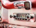A radio console in a classic car.