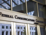 The front door of the headquarters of the Federal Communications Commission.