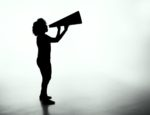 A woman yelling into a megaphone.